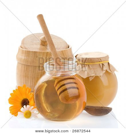 pot of honey isolated on white background