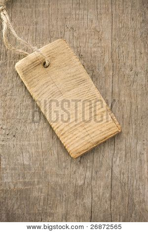 price tag over wood texture background