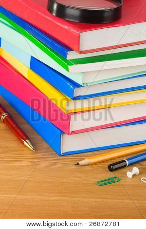 pile of books on wood background