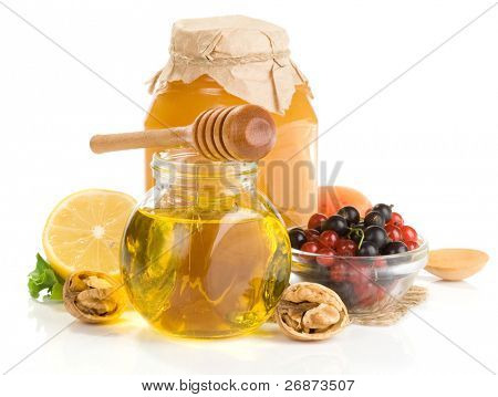 honey and fruit isolated on white background