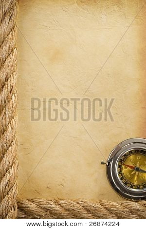 ropes and compass over old ancient paper background texture