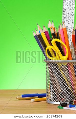 back to school concept on green background over wood board
