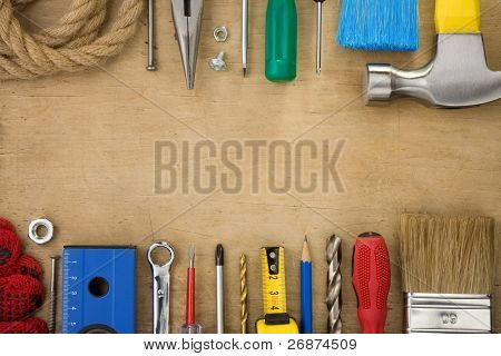 set of tools on wood texture background