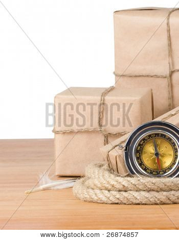 parcel wrapped box and rope on wood isolated over white background