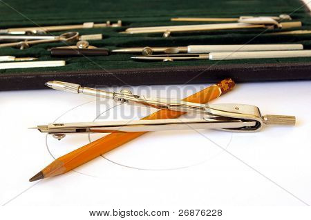 Professional case of drawing instruments on white