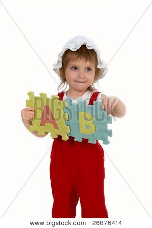 Little girl and letters on white background