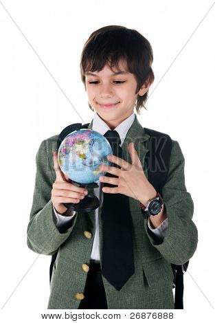Cute little boy with terrestrial globe on white background