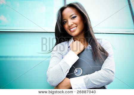 A pretty asian business woman at the office building