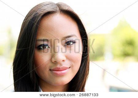 Beautiful young asian woman outdoors