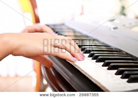 woman playing on electric piano