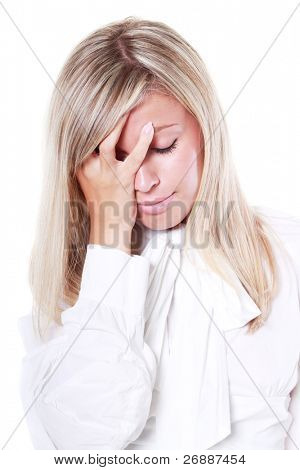 Young tired business woman suffering from headache isolated on white