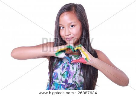 Beautiful asian girl showing a heart with her painted hands isolated