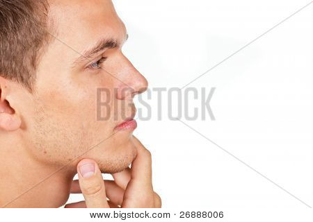 Closeup portrait of a thoughtful young man with hand on his chin