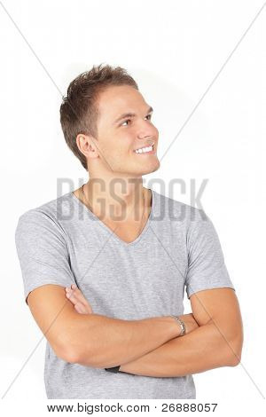 Portrait of happy smiling man with hands folded looking aside, isolated on white