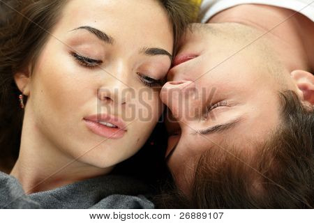 Young man kisses his beautiful girlfriend