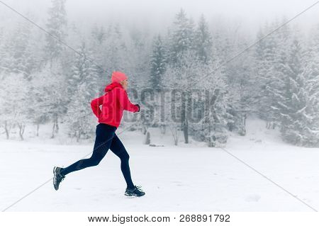 poster of Happy Girl Running On Snow In Winter Mountains. Sport, Fitness Inspiration And Motivation. Young Hap
