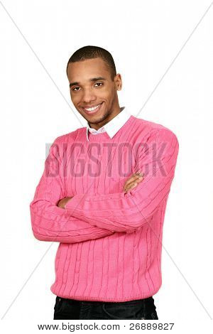 Young african-american man in pink sweater isolated over white background