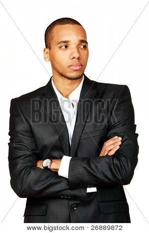 Portrait of a happy African-American young businessman looking aside isolated over white background