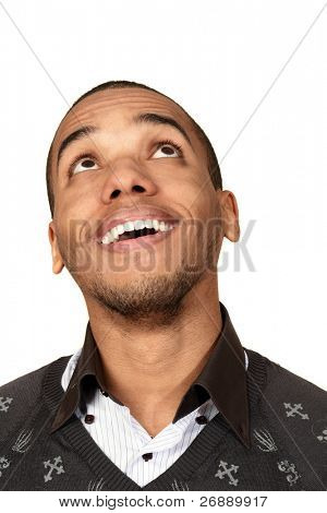 Closeup portrait of a happy african-american man looking up at copyspace
