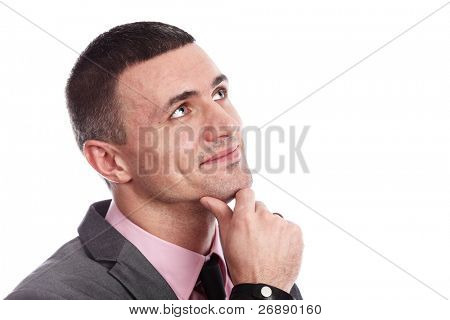 Handsome young business dreamy man isolated against white