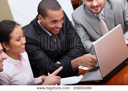 Multi ethnic business team at a meeting. Focus on african-american man