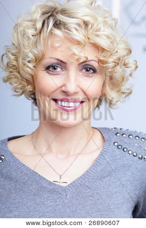 Smiling face of a middle-aged blonde pretty woman