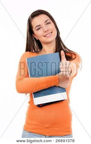 Young student with her books in hand giving thumb-up gesture, smiling and looking at the camera