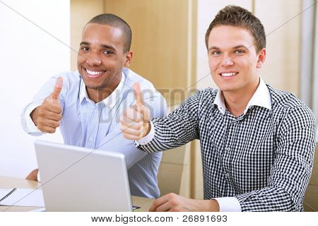 African american and caucasian businessmen showing thumbs up