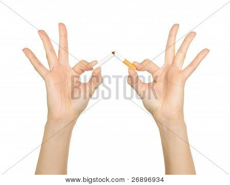 Female hands crushing cigarettes
