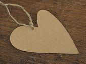 picture of grommets  - heart tag on the wooden background - JPG