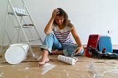 Painting Equipment In The Room With Blue Wall And Stressed With Renovations Women poster