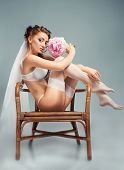 Portrait of a sexy bride wearing white lingerie
