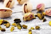 Pistachios, Roasted Pistachio Seeds In Shells And Shelled. Green, Dried Fruits, Whole And Chopped poster