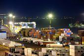 stock photo of railroad yard  - Port warehouse with cargoes and containers at night - JPG