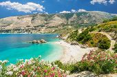 Vouti Beach, Kefalonia Island, Greece. People Relaxing At The Beach. The Beach Is Surrounded By Flow poster