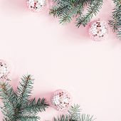 Christmas Composition. Frame Made Of Fir Tree Branches, Pink Balls On Pastel Pink Background. Christ poster