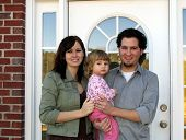 stock photo of dream home  - family at the front door of their new home - JPG