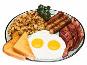 stock photo of bacon strips  - a traditional american breakfast of sunny side up eggs - JPG