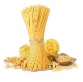 foto of pasta  - pasta and wooden spoon isolated on white background - JPG