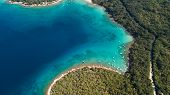 Aerial View Of Crystal Clear Water Off The Coastline In Croatia poster