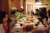 Blurred Of Group Of People Enjoy Eating Lunch Or Dinner In The Restaurant poster