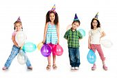 stock photo of little boy  - Kids in birthday caps isolated on white - JPG