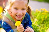 stock photo of happy day  - Cute little girl  on the meadow in spring day - JPG