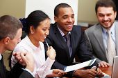 picture of business meetings  - Multi ethnic business team at a meeting - JPG