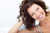 stock photo of beautiful woman face  - Beautiful woman lying on the sofa and laughing sincerely - JPG