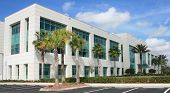 stock photo of commercial building  - Modern commercial building on a beautiful day - JPG