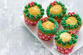 Christmas Wreath Cupcakes -  Beautiful And Delicious Homemade Cupcakes Decorated With Green Cream An poster