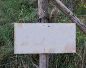 Empty Blank Signboard Plate On A Pole To Put Whatever You Want In A Nature Landscape With Grass poster