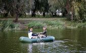 Friends Fishing From Boat On River. Recreational Activity poster