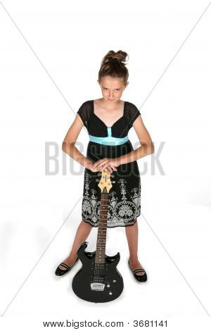 Pretty Girl In Black Dress With Electric Guitar